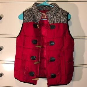 Red puffy vest with herringbone patterned top